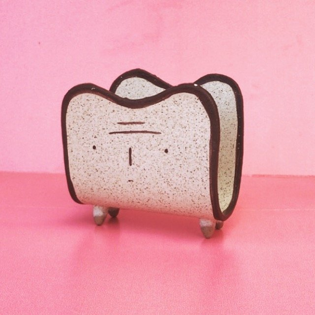 toast man napkin holder